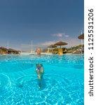 young woman enjoying in the... | Shutterstock . vector #1125531206