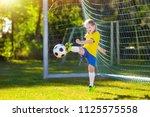 kids play football on outdoor...   Shutterstock . vector #1125575558