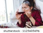 huge stress. dark haired woman...   Shutterstock . vector #1125605696