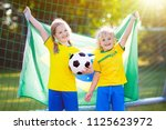 kids play football on outdoor... | Shutterstock . vector #1125623972