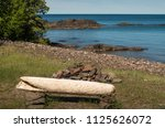 driftwood bench at lake superior | Shutterstock . vector #1125626072