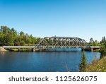 metal bridge over spanish river ... | Shutterstock . vector #1125626075