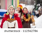 Teenager girl with pancake during  Shrovetide at Russia - stock photo