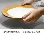 female hands hold a plate with... | Shutterstock . vector #1125716735