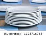 stacks of cleaned white plates... | Shutterstock . vector #1125716765