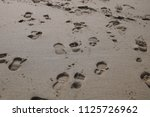 foot prints in the sand | Shutterstock . vector #1125726962