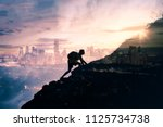 man climbing up mountain... | Shutterstock . vector #1125734738