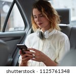 taxi passanger woman using... | Shutterstock . vector #1125761348
