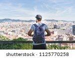 traveler man looking on a big... | Shutterstock . vector #1125770258