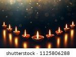 diya lamps on a reflective base ...   Shutterstock . vector #1125806288