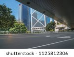 empty asphalt road and modern... | Shutterstock . vector #1125812306