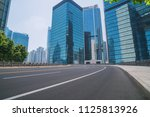 empty asphalt road and modern... | Shutterstock . vector #1125813926