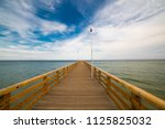 wooden pier to the baltic sea.... | Shutterstock . vector #1125825032