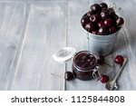 cherry marmalade in a glass jar ... | Shutterstock . vector #1125844808