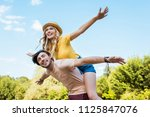 low angle view of happy couple... | Shutterstock . vector #1125847076