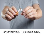 close up of male hands breaking ... | Shutterstock . vector #1125855302