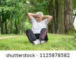 senior man stretching after... | Shutterstock . vector #1125878582