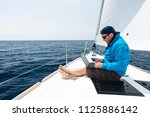 man working on sail yacht | Shutterstock . vector #1125886142
