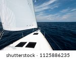 luxury yacht at sea race.... | Shutterstock . vector #1125886235