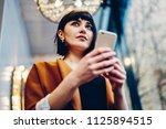 attractive hipster girl holding ... | Shutterstock . vector #1125894515