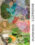mixed multi colored paint and a ... | Shutterstock . vector #1125900548