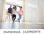 excited family exploring new... | Shutterstock . vector #1125902975