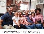 portrait of multi generation... | Shutterstock . vector #1125903122