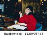 portrait of positive female... | Shutterstock . vector #1125905465