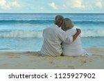 happy elderly couple resting   Shutterstock . vector #1125927902