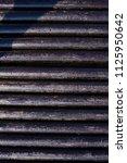 oil drill pipe. rusty drill... | Shutterstock . vector #1125950642