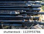 oil drill pipe. rusty drill... | Shutterstock . vector #1125953786