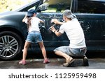 father and daughter wash the car | Shutterstock . vector #1125959498