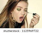 woman is applying mascara....   Shutterstock . vector #1125969722