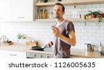 portrait of brunet man with... | Shutterstock . vector #1126005635