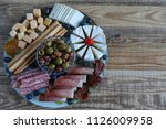 mixed cheese and meat antipasto ... | Shutterstock . vector #1126009958