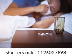 the pills and glass of water on ... | Shutterstock . vector #1126027898