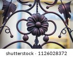 wrought iron gates  ornamental... | Shutterstock . vector #1126028372