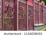 wrought iron gates  ornamental... | Shutterstock . vector #1126028432