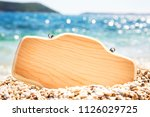 sign in the sand on the beach.... | Shutterstock . vector #1126029725