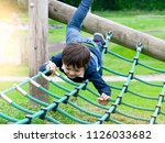 active boy playing outdoors  4... | Shutterstock . vector #1126033682