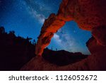 starry nights above an arch in... | Shutterstock . vector #1126052672