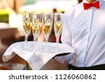 glasses with champagne on a... | Shutterstock . vector #1126060862