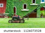 lawn mower on grass | Shutterstock . vector #1126073528