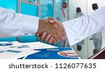 saudi arab businessmen shaking... | Shutterstock . vector #1126077635