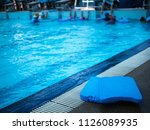 foam swimming poolside.... | Shutterstock . vector #1126089935