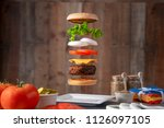exploded view of a cheeseburger ... | Shutterstock . vector #1126097105