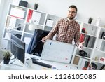 the man in the office is... | Shutterstock . vector #1126105085