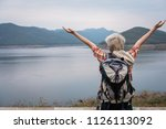 traveler hiker man with... | Shutterstock . vector #1126113092