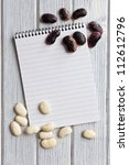 blank recipe book with beans on kitchentable - stock photo