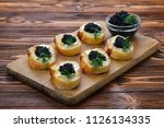 toastes with black caviar.... | Shutterstock . vector #1126134335